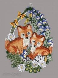 Zwei süße Füchse unterm Fingerhut