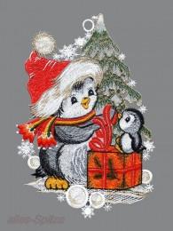 Zwei lustige Pinguine mit Weihnachtsmütze und Geschenkpaket aus Spitze