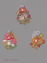 kleine Fensterbilder zeigen eine Igel, Kürbis oder Fliegenpilze für die Herbstdekoration