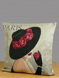 Hier wurde ein moderne Dame mit Hut in eine Gobelin-Kissenhülle gearbeitet.